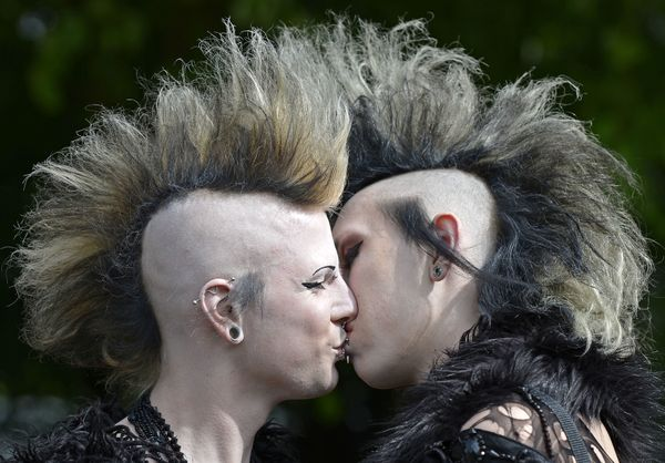 Wave Gothic Festival participants kiss in Leipzig, central Germany, on May 18, 2013. (AP Photo/Jens Meyer)
