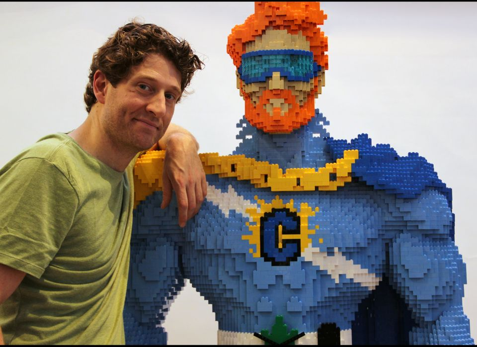 Nathan Sawaya is a professional Lego artist who was commissioned by Conan O'Brien to create a Lego sculpture of him as a supe