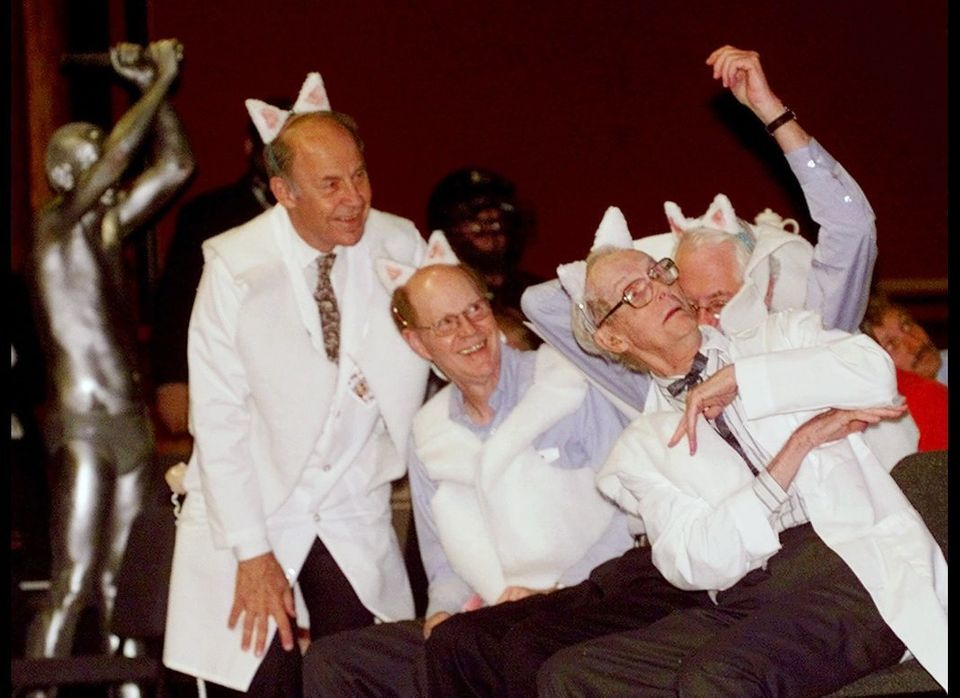 Wearing cloned sheep costumes, Nobel Prize winners William Lipscomb, right, (Chemistry 1976), Sheldon Glashow, behind Libscom