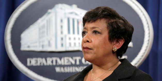 Attorney General Loretta E. Lynch stands during the announcement of law enforcement action against the state of North Carolin