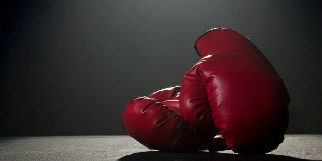 Boxing gloves in spotlight