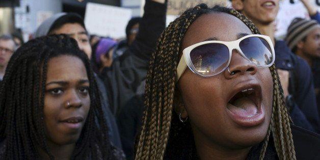 Black Lives Matter protesters shout during Black Friday in Seattle, Washington November 27, 2015. REUTERS/David Ryder