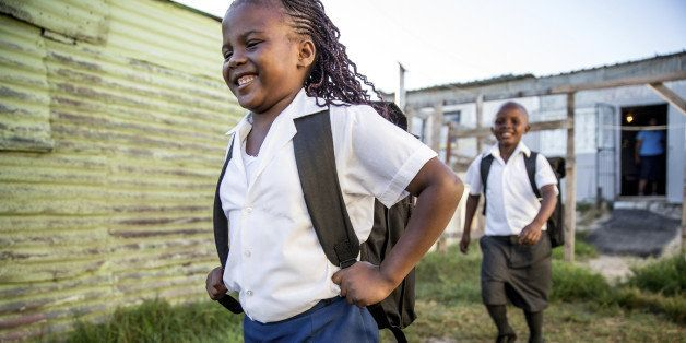 African primary school kids in theirs uniforms going to school. Image from South Africa.