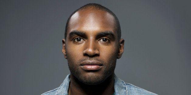 Dark skinned man looking straight into camera