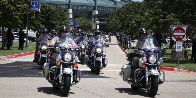 DALLAS, USA - JULY 13: Motorcycle Policemen escort the casket of slain Lorne Ahrens on the way of Restland Memorial Park's Ga