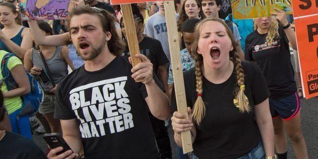 Black Lives Matter protestors shout slogans during a Black Lives Matter protest march thru the streets in Washington, DC on J