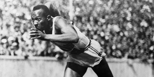 FILE - This 1936 file photo shows Jesse Owens in action in a 200-meter preliminary heat at the 1936 Summer Olympic Games in B
