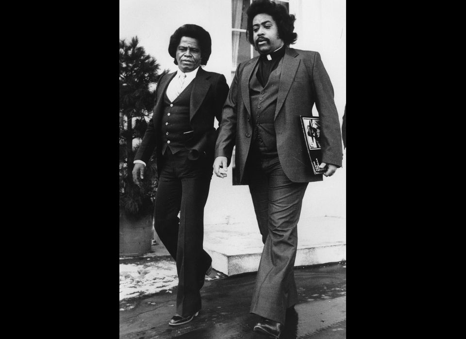 Singer James Brown, left, walks with Rev. Al Sharpton from the White House in Washington, D.C. on Jan. 15, 1982.  They met wi