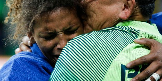 Brazil's Rafaela Silva, left, reacts after winning the gold medal of the women's 57-kg judo competition at the 2016 Summer Ol