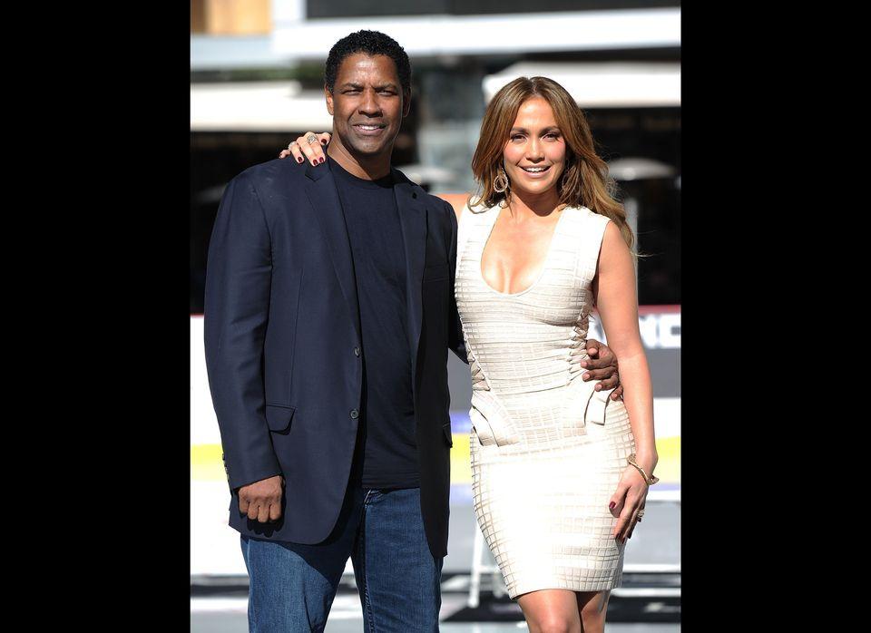 LOS ANGELES, CA - NOVEMBER 30:  Actress Jennifer Lopez and actor Denzel Washington pose as Denzel Washington announces Jennif