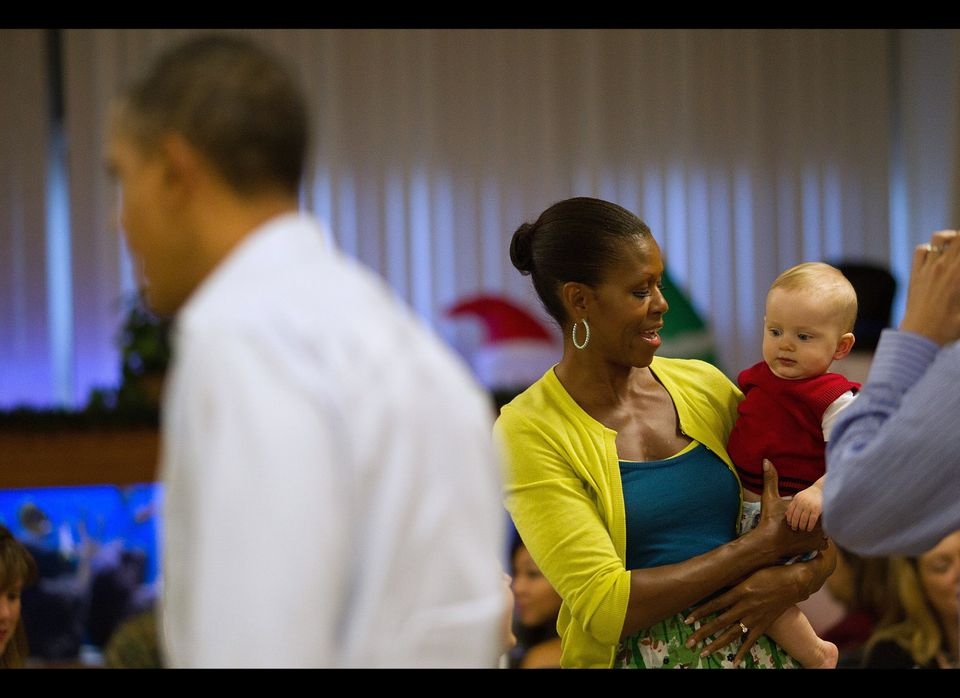 First lady Michelle Obama holds eight-month-old Cooper Wall Wagner in Anderson Hall mess hall at Marine Corps Base Hawaii on