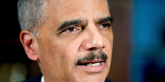 FILE - In this March 12, 2015, file photo, Attorney General Eric Holder announces six pilot cities for the National Initiativ