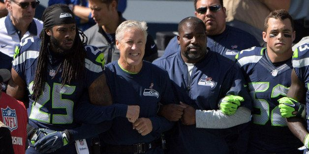Sep 11, 2016; Seattle, WA, USA; Seattle Seahawks head coach Pete Carroll and cornerback Richard Sherman (25) interlock elbows