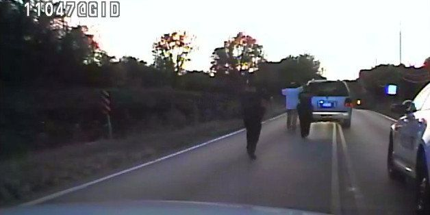 In this image made from a Friday, Sept. 16, 2016 police video, Terence Crutcher, center, is pursued by police officers as he