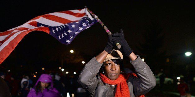 Demonstrators march in Ferguson, Missouri, on November 22, 2014, during a march to protest the death of 18-year-old Michael B