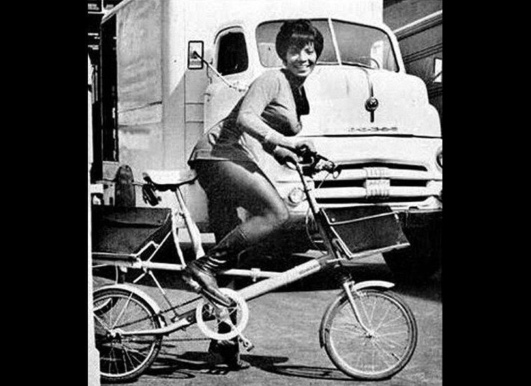 "Actress Nichelle Nichols, wearing her Lt. Uhura costume, bicycles along at warp speed in between scenes of ""Star Trek"" at the"