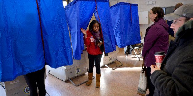 A voter leaves the polling booth during the U.S. presidential election in Philadelphia, Pennsylvania, U.S. November 8, 2016.