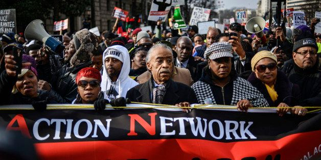 Al Sharpton (C) leads a march with family members of Eric Garner, Michael Brown, Tamir Rice and Trayvon Martin to Capitol Hil