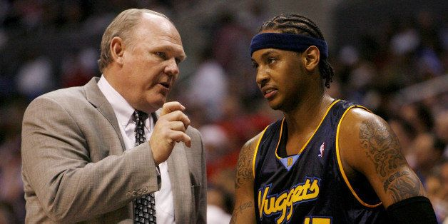 Denver Nuggets head coach George Karl (L) talks with Carmelo Anthony during a time out of their 98-87 loss to the Los Angeles