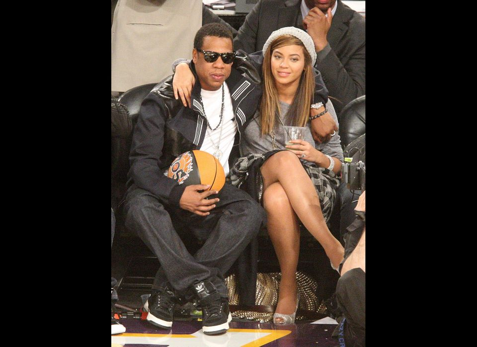 PHOENIX - FEBRUARY 15:  Rapper Jay-Z (L) and singer Beyonce Knowles sit in the audience during the 58th NBA All-Star Game, pa