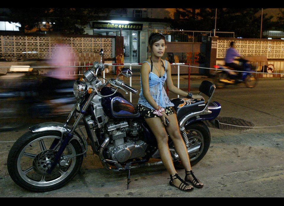 In this picture taken on August 18, 2009, a Thai bar girl waits for customers outside a bar in Sungai Kolok, in Thailand's so