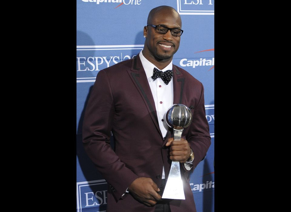 San Francisco 49ers tight end Vernon Davis poses backstage with the award for best game at the ESPY Awards on Wednesday, July