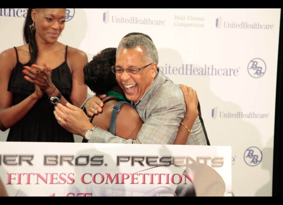 Dr. Reed Tuckson hugs stylist Linette Battle, who took home the $5,000 grand prize. Runners-up include: