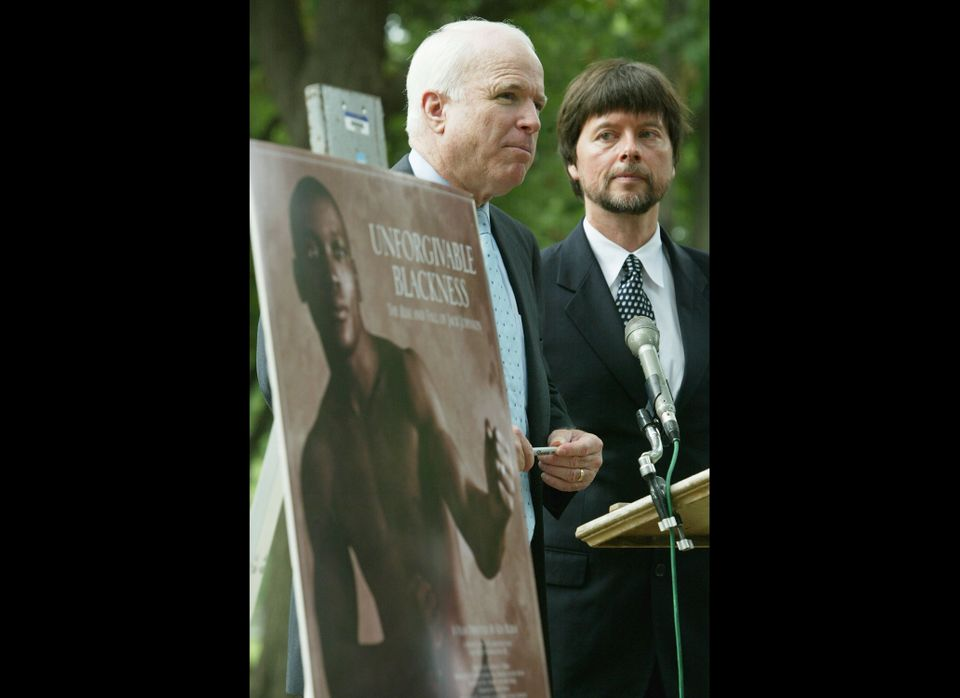 WASHINGTON - JULY 13:  U.S. Senator John McCain (R-AZ) (C) speaks as documentary filmmaker Ken Burns (R) looks on during a me