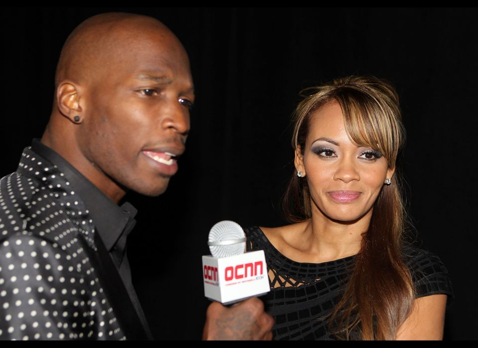 DALLAS, TX - FEBRUARY 05:  NFL player Chad Ochocinco and Evelyn Lozada pose with Motorola Xoom at the Maxim Party Powered by