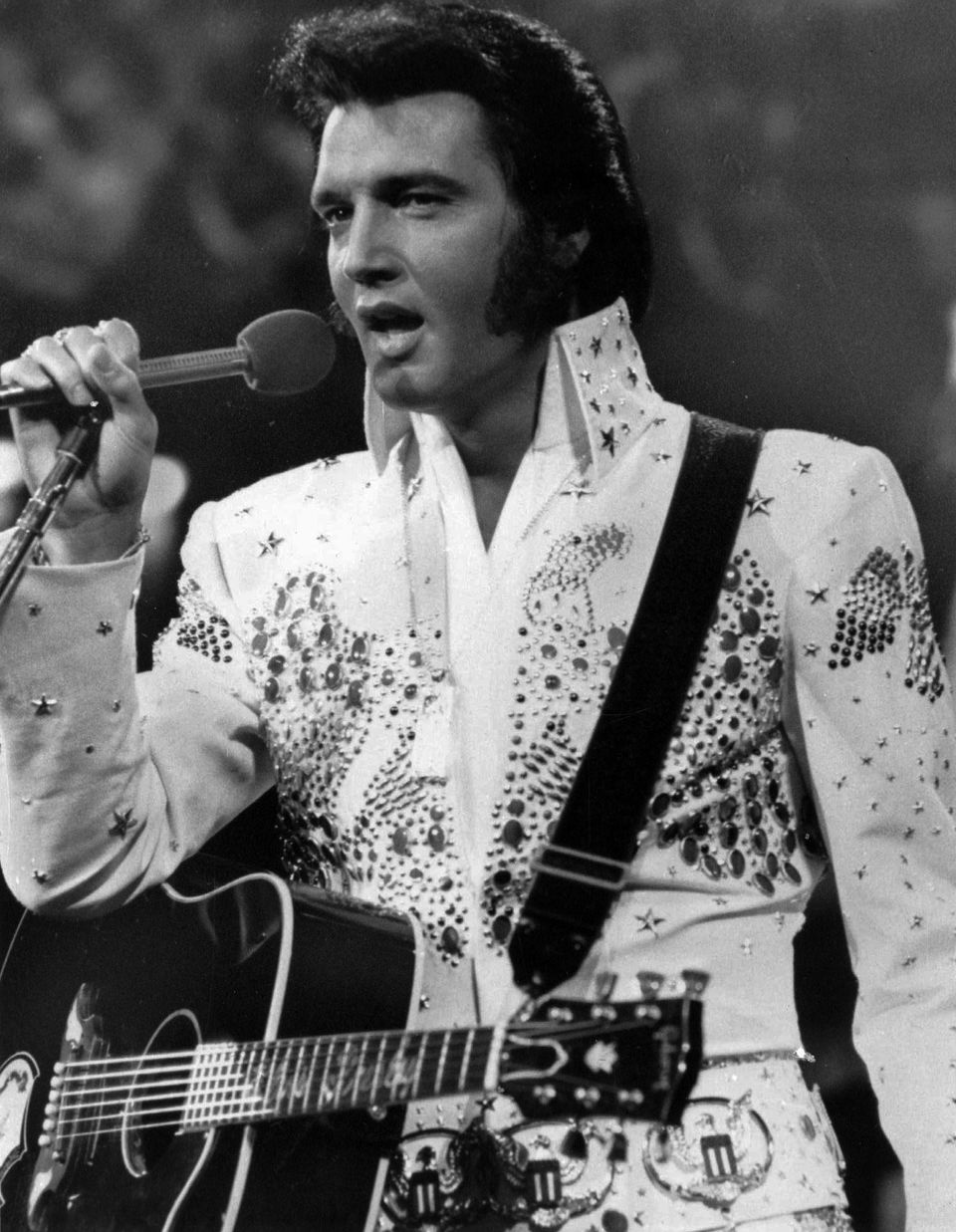 FILE - In this undated file photo released by NBC-TV, singer Elvis Presley is shown in concert in the later part of his caree