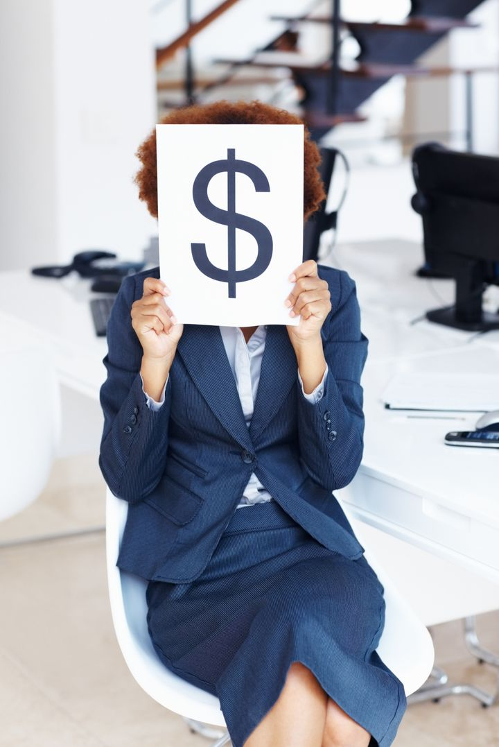 business woman holding dollar...