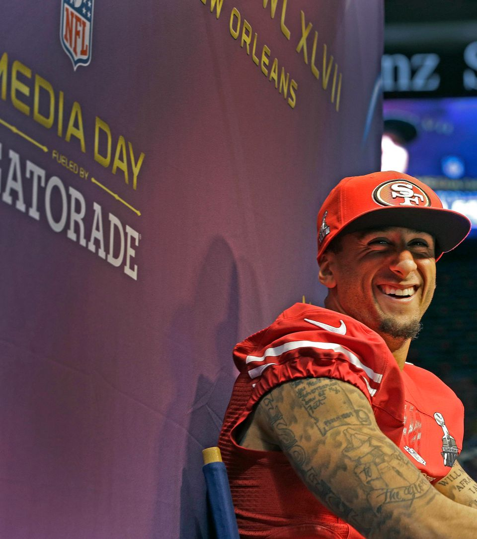San Francisco 49ers quarterback Colin Kaepernick smiles as he answers questions during media day for the NFL Super Bowl XLVII