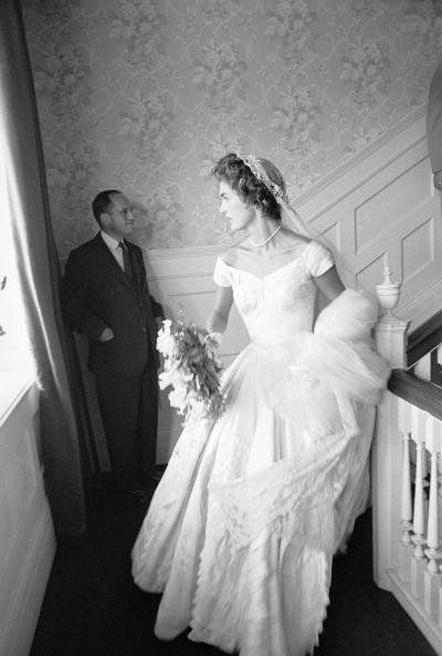 Socialite Jacqueline Bouvier in wedding dress on landing in home on day of her marriage to Sen. John Kennedy. (Photo by Lisa
