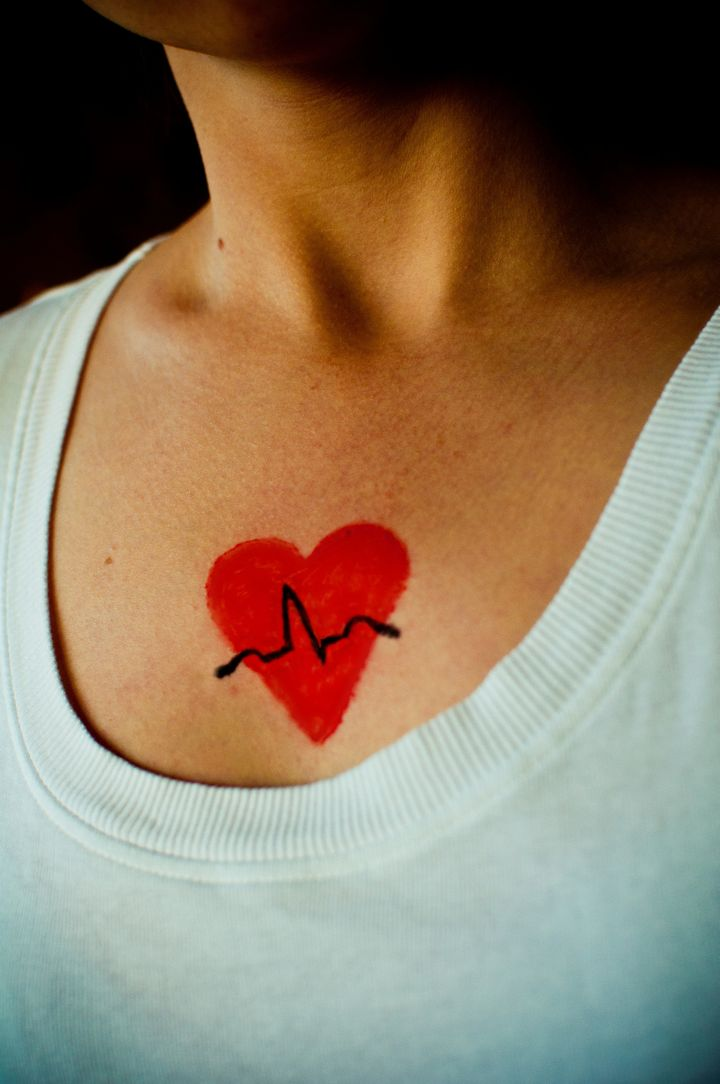 Painted on heart and ECG trace.