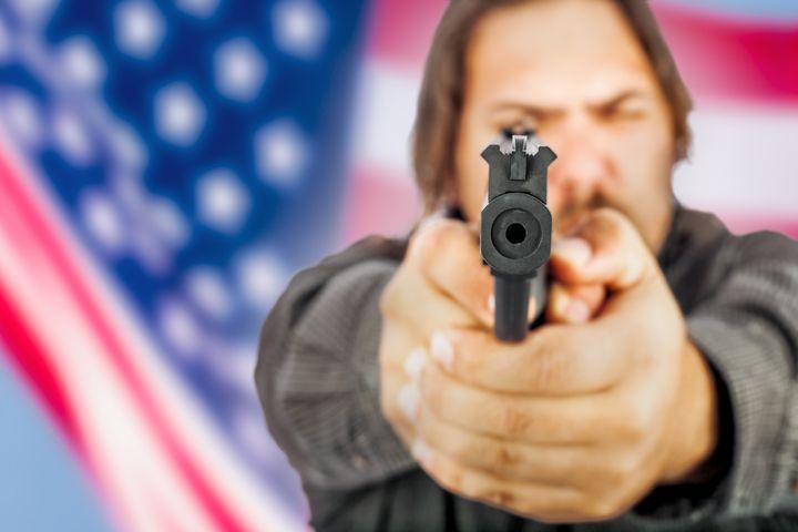white male holding a handgun...