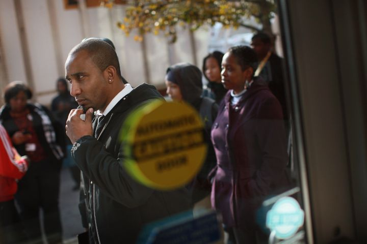 CHICAGO, IL - NOVEMBER 09:  Job seekers wait in line outside Kennedy-King College to attend a job fair hosted by the city of