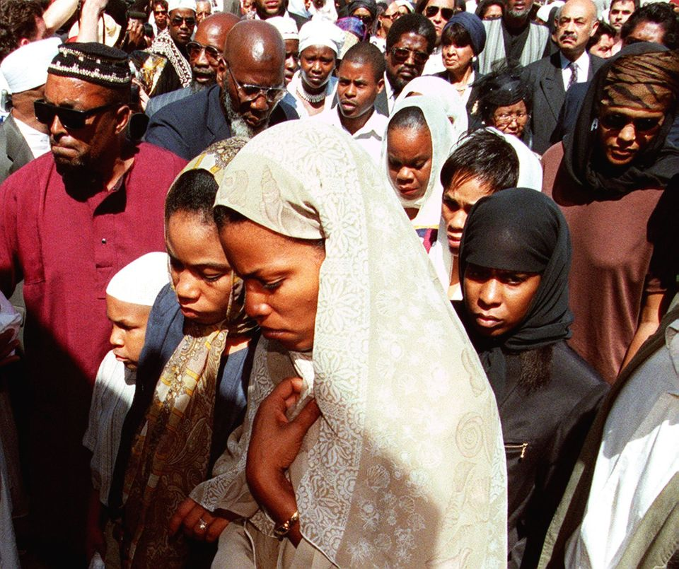 NEW YORK, NY - JUNE 27:  Two of the daughters of Betty Shabazz, leave the Islamic Cultural Center in New York, surrounded by