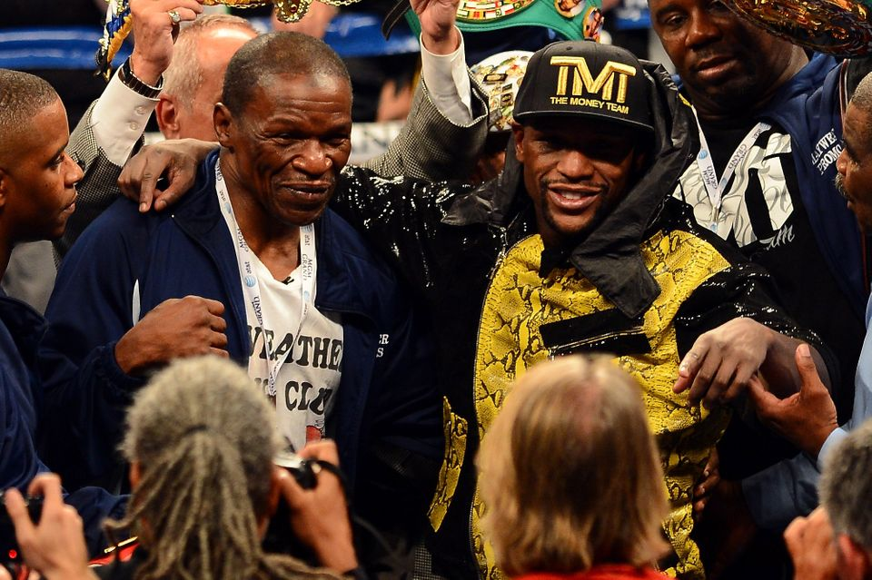 LAS VEGAS, NV - MAY 04:  Trainer Floyd Mayweather Sr. and boxer Floyd Mayweather Jr. celebrate the unanimous decision victory