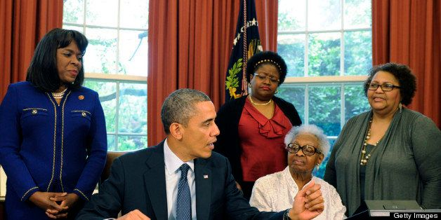 WASHINGTON, DC - MAY 24: US President Barack Obama (2nd L) speaks as he signs a bill in the Oval Office designating the Congressional Gold Medal to commemorate the four young girls killed during the 1963 bombing of 16th Street Baptist Church in Birmingham, Alabama, as (L-R) Rep Terri Sewell (D-AL), Thelma Pippen McNair, mother of Denise McNair, Lisa McNair, sister of Denise McNair, Dianne Braddock, sister of Carole Robertson, Rev Arthur Price, Jr, pastor 16th Street Baptist Church, and former U.S. Attorney Gordon Douglas Jones look on May 24, 2013 in Washington, DC. The medal, the highest Congressional civilian honor, was given posthumously to Addie Mae Collins, Carole Robertson, Cynthia Wesley and Denise McNair who died September 15, 1963 when a bomb planted bywhite supremacists exploded exploded at the church. (Photo by Mike Theiler-Pool/Getty Images