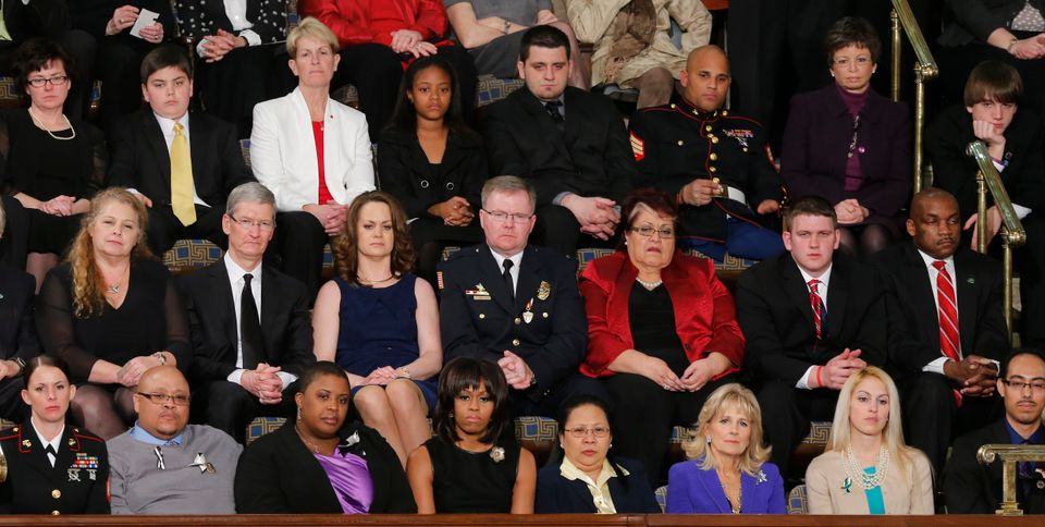 First lady Michelle Obama, front row, center, and other, listen as President Barack Obama gives his State of the Union addres