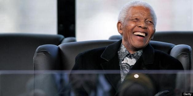 Former South African President and Nobel Peace prize laureate Nelson Mandela reacts during the inauguration of unseen Preside