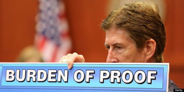 SANFORD, FL - JULY 12:  Defense attorney Mark O'Mara holds up a chart during closing arguments for the defence in Zimmerman's