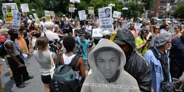 A man holds a cardboard cutout of Trayvon Martin during a demonstration in New York on July 14, 2013. Protests were held one