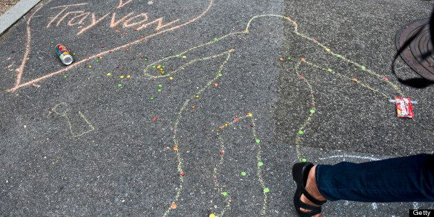 WASHINGTON DC - JULY 20:  A chalk drawing decorates the sidewalk next to a 'Justice for Trayvon' vigil sponsored by The Natio