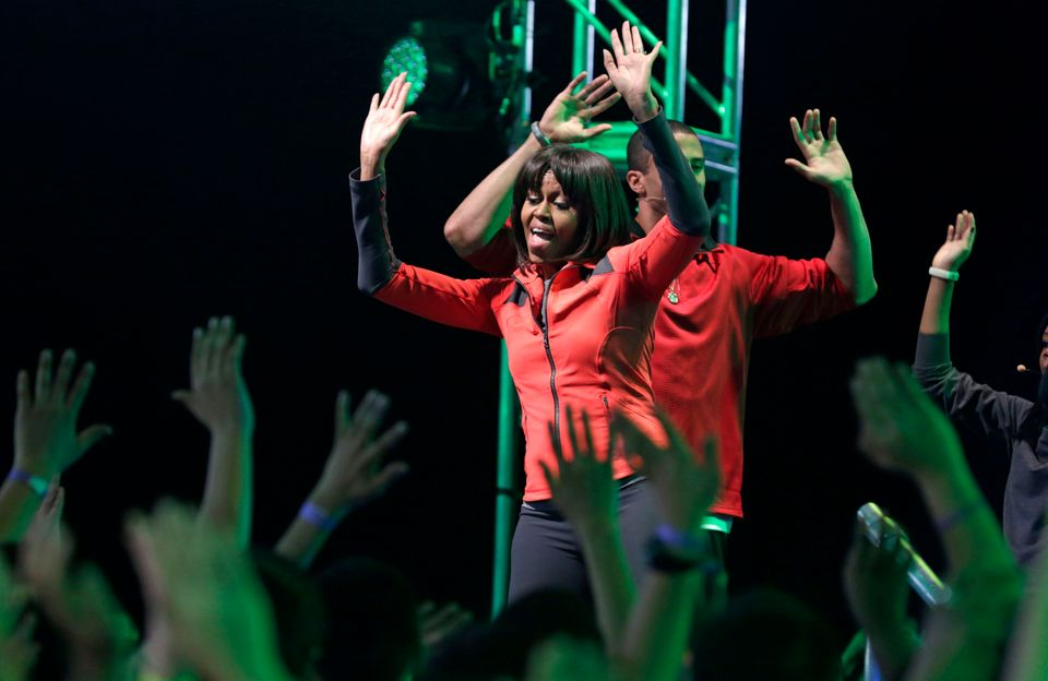 First lady Michelle Obama exercises with children from Chicago Public Schools, in her hometown of Chicago, Thursday, Feb. 28,