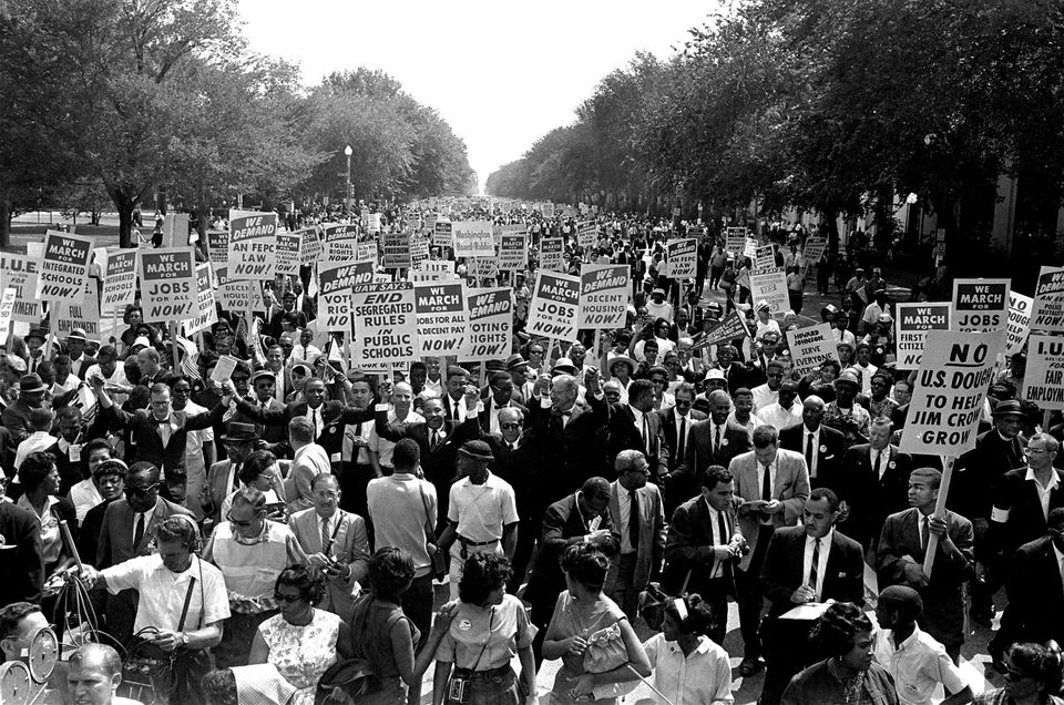 FILE - In this Aug. 28, 1963, file photo Dr. Martin Luther King Jr., center left with arms raised, marches along Constitution