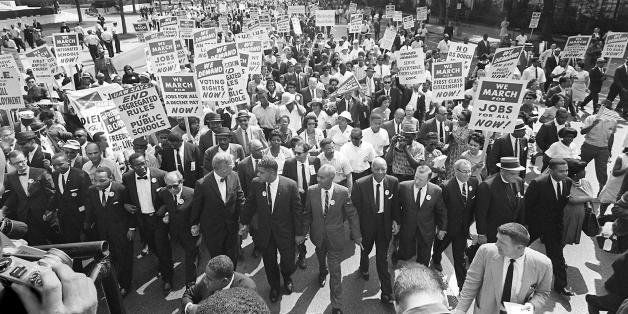 WASHINGTON, :  US civil rights leader Martin Luther King,Jr. (3rd from L) walks with supporters during the 'March on Washingt