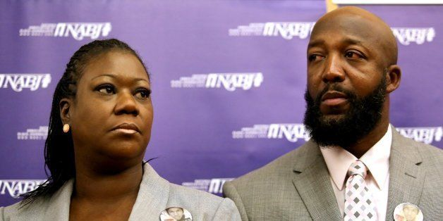 The parents of Trayvon Martin, Sybrina Fulton, left, and Tracy Martin, listen to their attorneys, during a news conference at