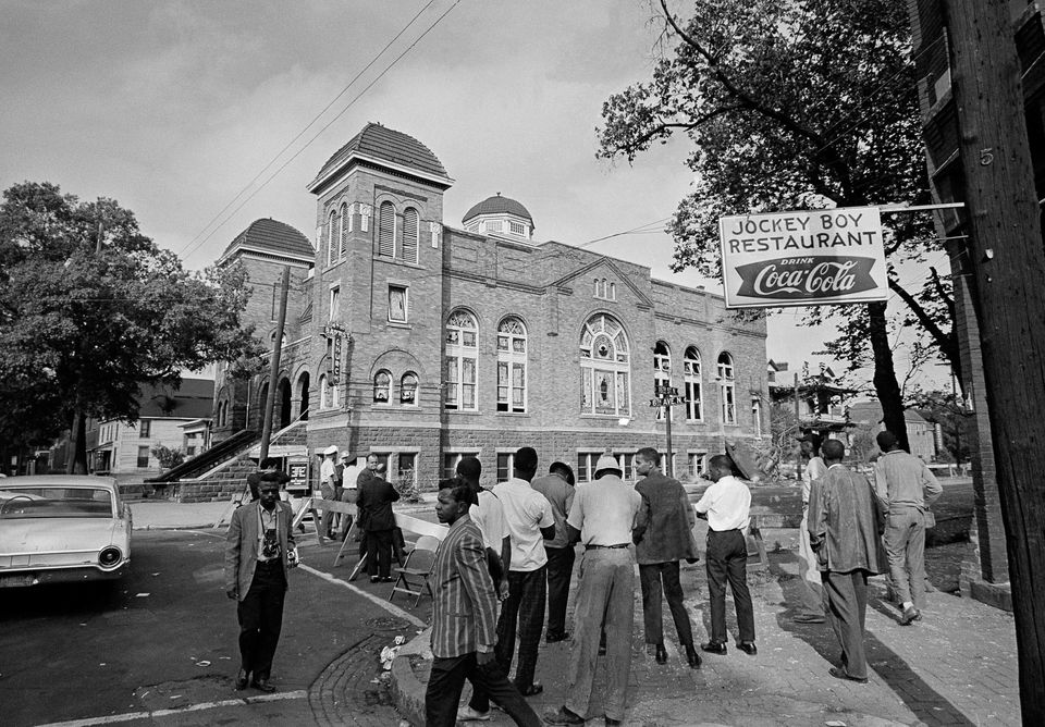 FILE - A Sept. 16, 1963 file photo shows investigators and spectators outside the 16th Street Baptist Church in Birmingham, A