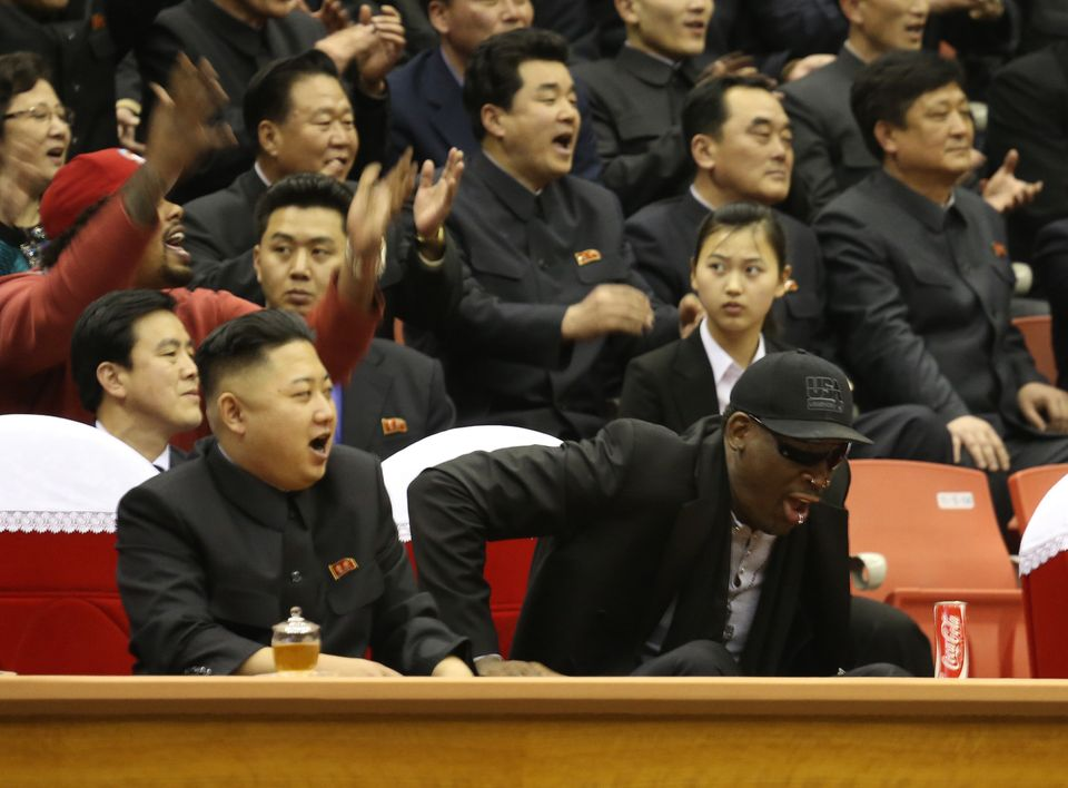 North Korean leader Kim Jong Un, left, and former NBA star Dennis Rodman watch North Korean and U.S. players in an exhibition